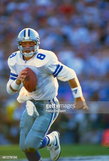 Troy Aikman of the Dallas Cowboys scrambles with the ball against the Buffalo Bills during Super Bowl XXVII on January 31 1993 at The Rose Bowl in...