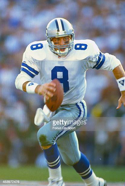 Troy Aikman of the Dallas Cowboys scrambles with the ball against the Pittsburgh Steelers during Super Bowl XXX on January 28 1996 at Sun Devil...