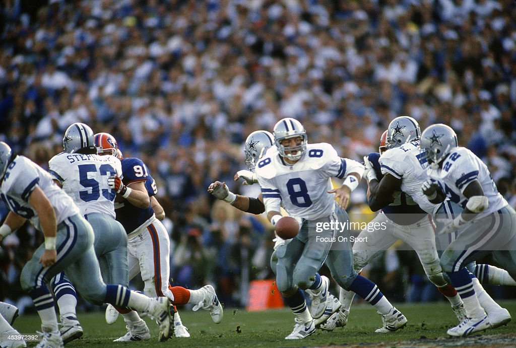Troy Aikman #8 of the Dallas Cowboys turns to hand the ball off to running back Emmitt Smith #22 against the Buffalo Bills during Super Bowl XXVII on January 31, 1993 at The Rose Bowl in Pasadena, California. The Cowboys won the Super Bowl 52-17.