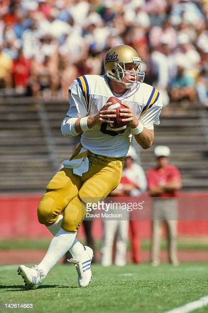 Troy Aikman of the UCLA Bruins throws a pass during a PAC 10 college football game against Stanford University played on October 3 1987 at Stanford...