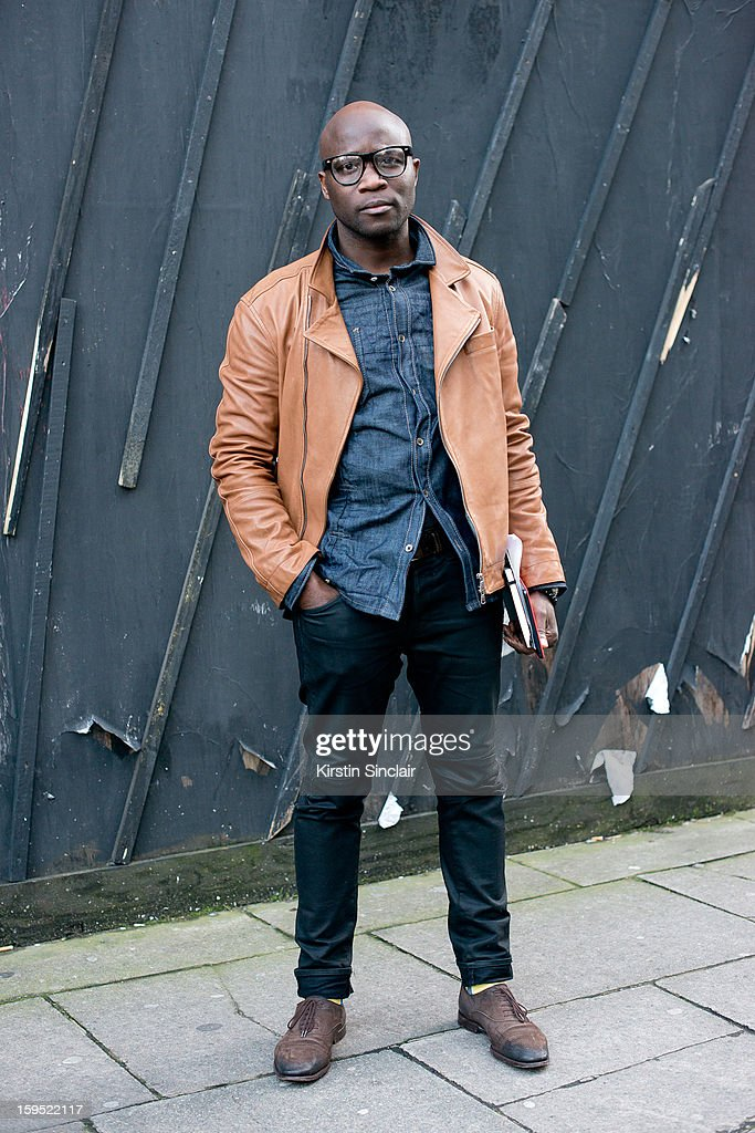 Troy Alexander fashion editor at Bite Magazine wearing Gucci shoes, Paul Smith socks, J brand jeans, Brunello Cucinelli jacket, a shirt from Brooklyn and glasses from harlem market on day 3 of London Mens Fashion Week Autumn/Winter 2013, on January 09, 2013 in London, England.