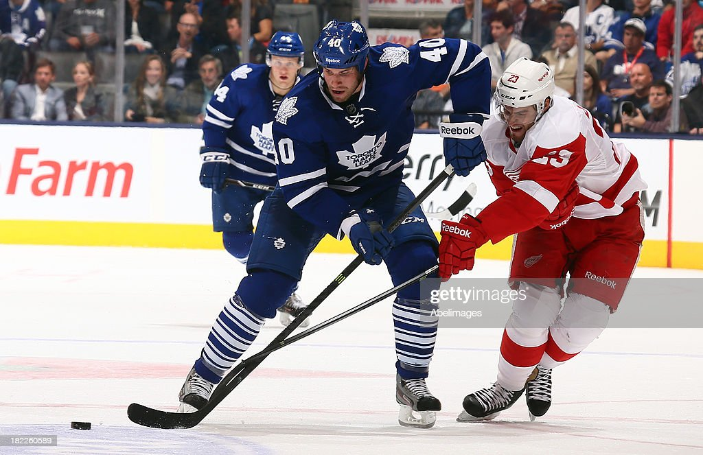 <a gi-track='captionPersonalityLinkClicked' href=/galleries/search?phrase=Troy+Bodie&family=editorial&specificpeople=2126082 ng-click='$event.stopPropagation()'>Troy Bodie</a> #40 of the Toronto Maple Leafs gets away from <a gi-track='captionPersonalityLinkClicked' href=/galleries/search?phrase=Brian+Lashoff&family=editorial&specificpeople=5529056 ng-click='$event.stopPropagation()'>Brian Lashoff</a> #23 of the Detroit Red Wings during NHL Preseason action at the Air Canada Centre September 28, 2013 in Toronto, Ontario, Canada.