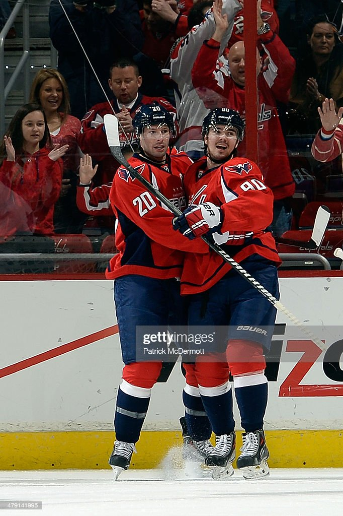 Troy Brouwer #20 celebrates with Marcus Johansson #90 of the Washington Capitals after scoring a goal in the first period during an NHL game against the Toronto Maple Leafs at Verizon Center on March 16, 2014 in Washington, DC.