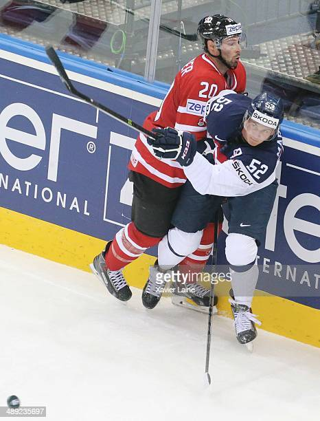 Troy Brouwer of Canada pushes Martin Marincin of Slovakia during the 2014 IIHF World Championship at Chizhovka Arena on May 10 2014 in Minsk Belarus
