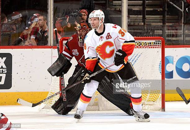 Troy Brouwer of the Calgary Flames looks for the puck while attempting to screen Mike Smith of the Arizona Coyotes at Gila River Arena on December 8...