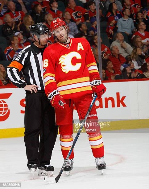 Troy Brouwer of the Calgary Flames talks with referee Chris Lee against the Edmonton Oilers at Scotiabank Saddledome on January 21 2017 in Calgary...