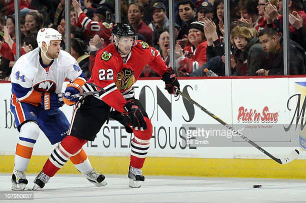 Troy Brouwer of the Chicago Blackhawks approaches the puck as Rob Schremp of the New York Islanders follows behind on January 9 2011 at the United...