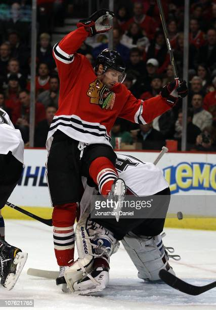 Troy Brouwer of the Chicago Blackhawks collides with Craig Anderson of the Colorado Avalanche at the United Center on December 15 2010 in Chicago...