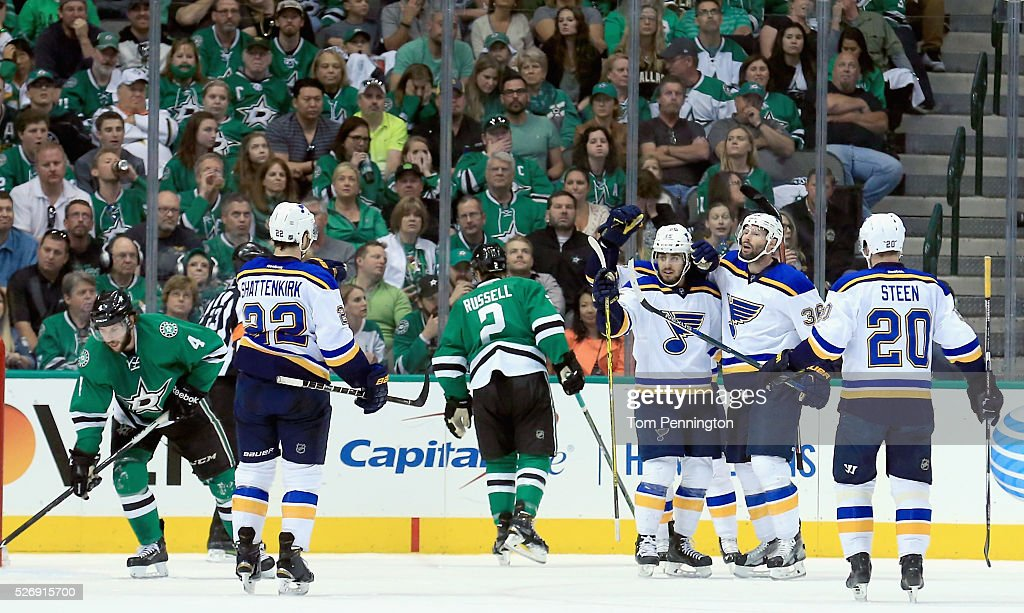 Troy Brouwer #36 of the St. Louis Blues celebrates with Robby Fabbri #15 of the St. Louis Blues and Alexander Steen #20 of the St. Louis Blues after scoring against the Dallas Stars in the first period in Game Two of the Western Conference Second Round during the 2016 NHL Stanley Cup Playoffs at American Airlines Center on May 1, 2016 in Dallas, Texas.
