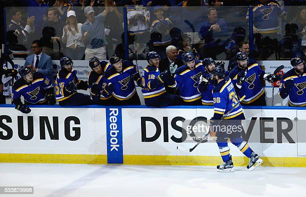 Troy Brouwer of the St Louis Blues celebrates with teammates after scoring a first period goal against the San Jose Sharks in Game Five of the...