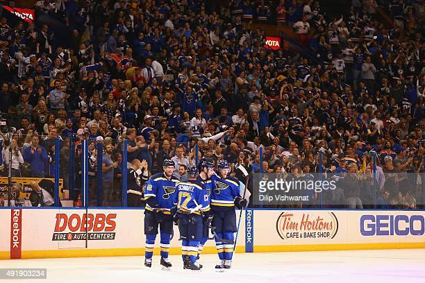 Troy Brouwer of the St Louis Blues is congratulated by teammates after scoring his first goal as a member of the Blues against the Edmonton Oilers at...
