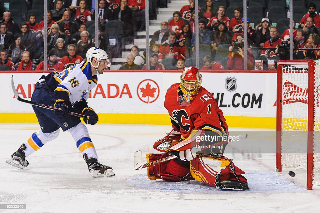 Troy Brouwer #36 of the St Louis Blues scores against Jonas Hiller #1 of the Calgary Flames at Scotiabank Saddledome on October 13, 2015 in Calgary, Alberta, Canada.
