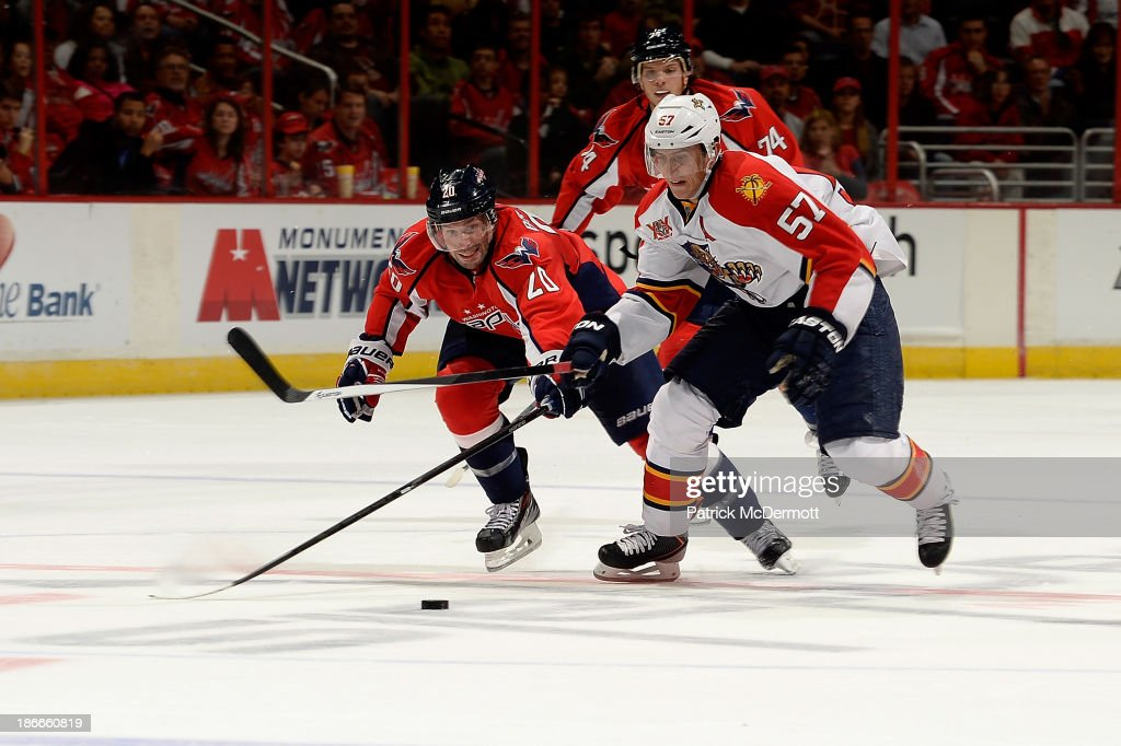 <a gi-track='captionPersonalityLinkClicked' href=/galleries/search?phrase=Troy+Brouwer&family=editorial&specificpeople=4155305 ng-click='$event.stopPropagation()'>Troy Brouwer</a> #20 of the Washington Capitals and <a gi-track='captionPersonalityLinkClicked' href=/galleries/search?phrase=Marcel+Goc&family=editorial&specificpeople=541626 ng-click='$event.stopPropagation()'>Marcel Goc</a> #57 of the Florida Panthers fight for the puck during an NHL game at Verizon Center on November 2, 2013 in Washington, DC.