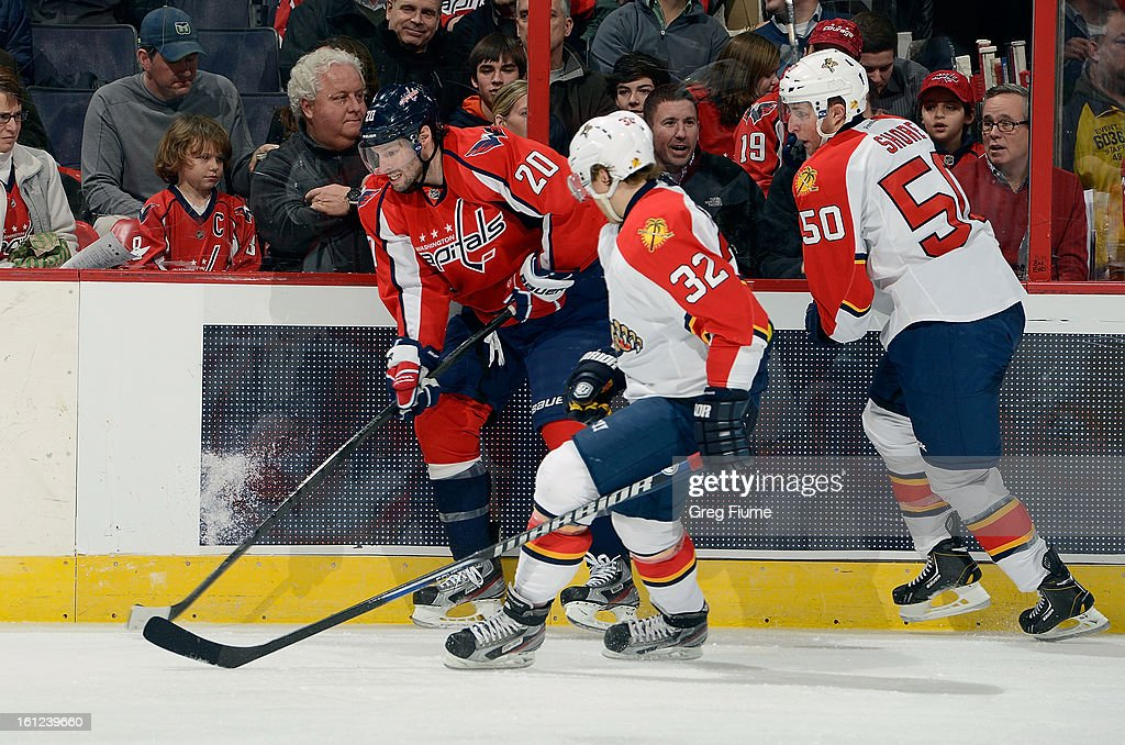 <a gi-track='captionPersonalityLinkClicked' href=/galleries/search?phrase=Troy+Brouwer&family=editorial&specificpeople=4155305 ng-click='$event.stopPropagation()'>Troy Brouwer</a> #20 of the Washington Capitals battles for the puck against <a gi-track='captionPersonalityLinkClicked' href=/galleries/search?phrase=Kris+Versteeg&family=editorial&specificpeople=2242969 ng-click='$event.stopPropagation()'>Kris Versteeg</a> #32 and Drew Shore #50 of the Florida Panthers at the Verizon Center on February 9, 2013 in Washington, DC.