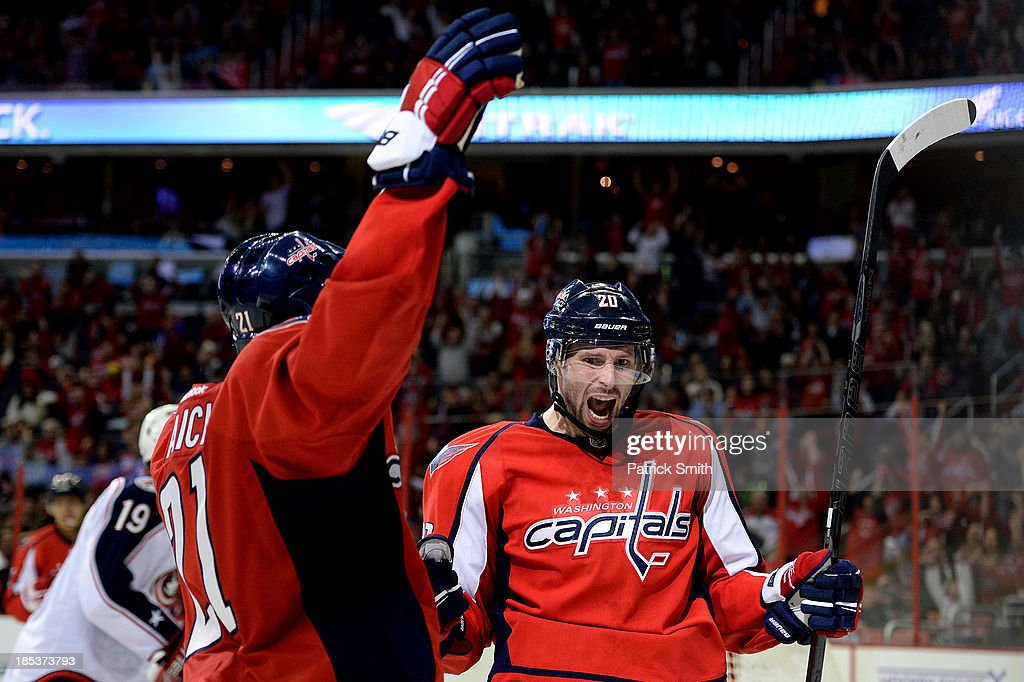<a gi-track='captionPersonalityLinkClicked' href=/galleries/search?phrase=Troy+Brouwer&family=editorial&specificpeople=4155305 ng-click='$event.stopPropagation()'>Troy Brouwer</a> #20 of the Washington Capitals celebrates after scoring a goal against the Columbus Blue Jackets in the third period at the Verizon Center on October 19, 2013 in Washington, DC.