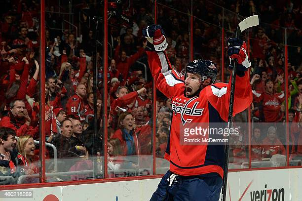 Troy Brouwer of the Washington Capitals celebrates after scoring a goal in the second period during an NHL game against the Carolina Hurricanes at...