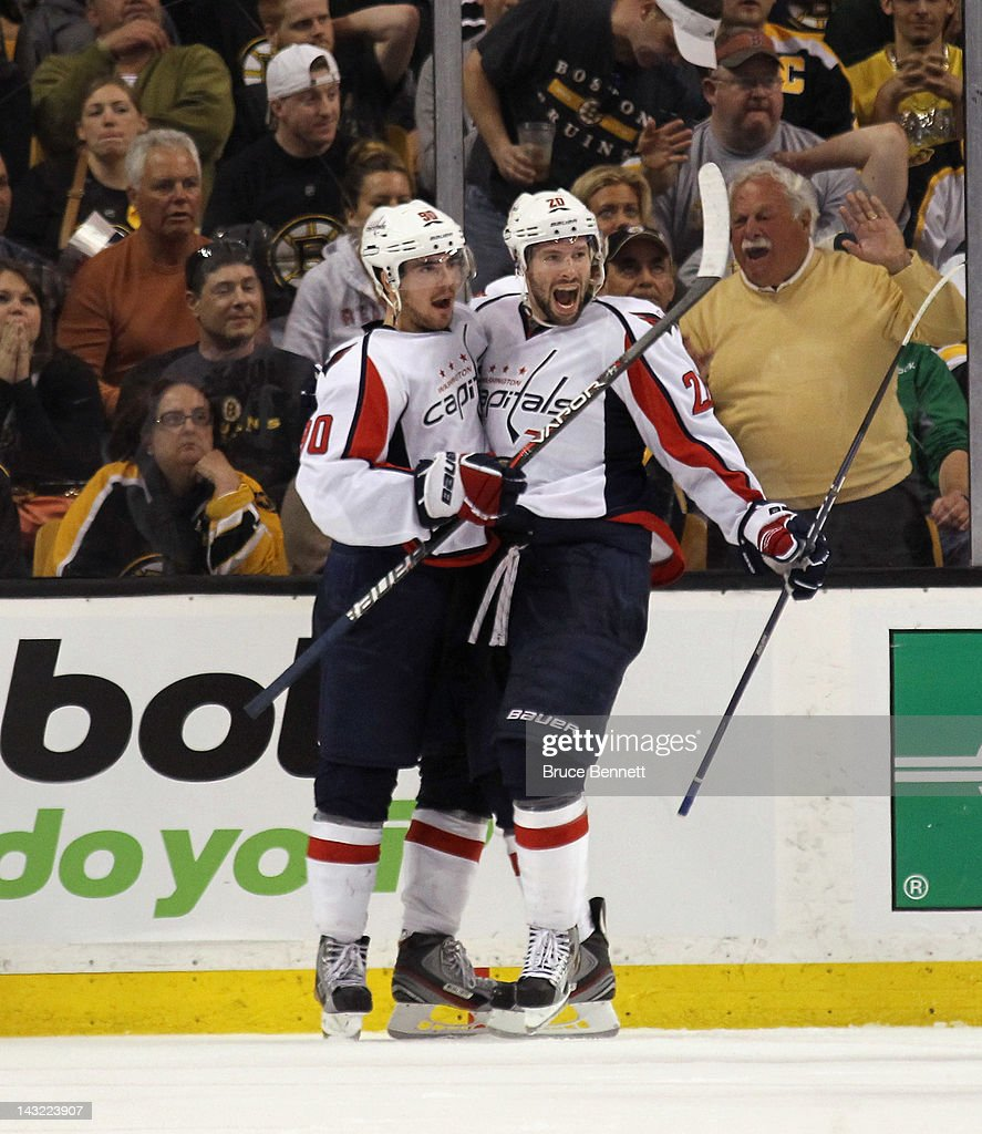 Troy Brouwer of the Washington Capitals celebrates his game winning powerplay goal at 1833 along with Marcus Johansson against the Boston Bruins in...