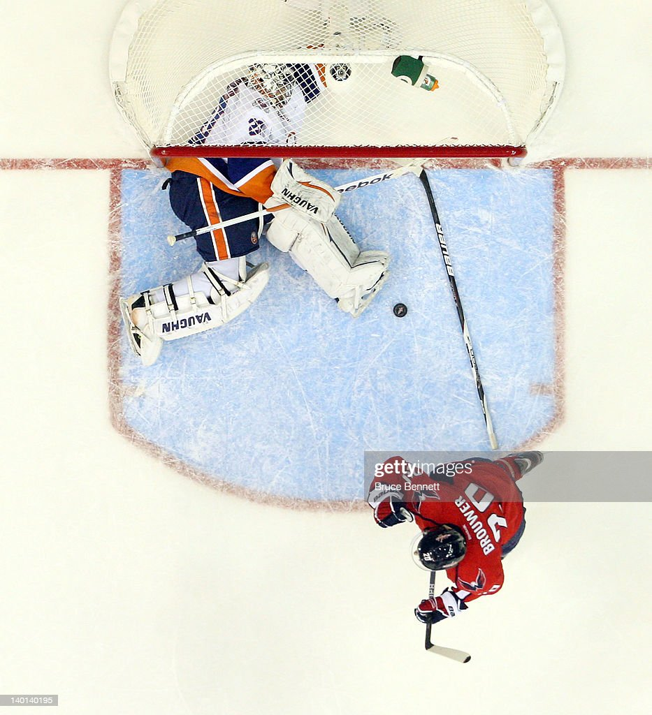 <a gi-track='captionPersonalityLinkClicked' href=/galleries/search?phrase=Troy+Brouwer&family=editorial&specificpeople=4155305 ng-click='$event.stopPropagation()'>Troy Brouwer</a> #20 of the Washington Capitals celebrates his goal at 16:31 of the third period against <a gi-track='captionPersonalityLinkClicked' href=/galleries/search?phrase=Evgeni+Nabokov&family=editorial&specificpeople=171380 ng-click='$event.stopPropagation()'>Evgeni Nabokov</a> #20 of the New York Islanders at the Verizon Center on February 28, 2012 in Washington, DC. The Capitals defeated the Islanders 3-2 in overtime.