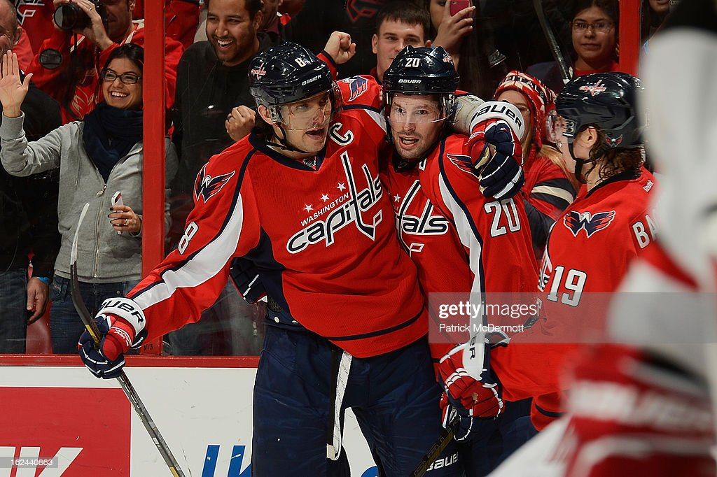 <a gi-track='captionPersonalityLinkClicked' href=/galleries/search?phrase=Troy+Brouwer&family=editorial&specificpeople=4155305 ng-click='$event.stopPropagation()'>Troy Brouwer</a> #20 of the Washington Capitals celebrates with Alex Ovechkin #8 and Nicklas Backstrom #19 of the Washington Capitals after scoring a goal during the third period of an NHL game against the New Jersey Devils at Verizon Center on February 23, 2013 in Washington, DC.