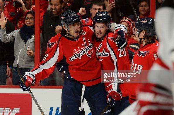 Troy Brouwer of the Washington Capitals celebrates with Alex Ovechkin and Nicklas Backstrom of the Washington Capitals after scoring a goal during...