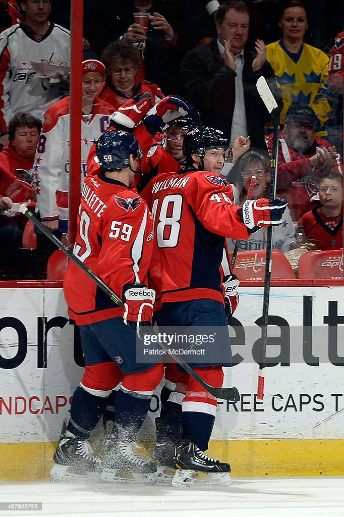 <a gi-track='captionPersonalityLinkClicked' href=/galleries/search?phrase=Troy+Brouwer&family=editorial&specificpeople=4155305 ng-click='$event.stopPropagation()'>Troy Brouwer</a> #20 of the Washington Capitals celebrates with his teammates after scoring a goal in the first period during an NHL game against the Winnipeg Jets at Verizon Center on February 6, 2014 in Washington, DC.