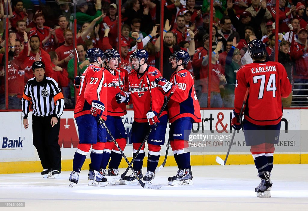 Troy Brouwer #20 of the Washington Capitals celebrates with teammates Karl Alzner #27, Nicklas Backstrom #19, Marcus Johansson #90, and John Carlson #74 after scoring an empty net goal during the third period of the Capitals 4-2 win over the Toronto Maple Leafs at Verizon Center on March 16, 2014 in Washington, DC.