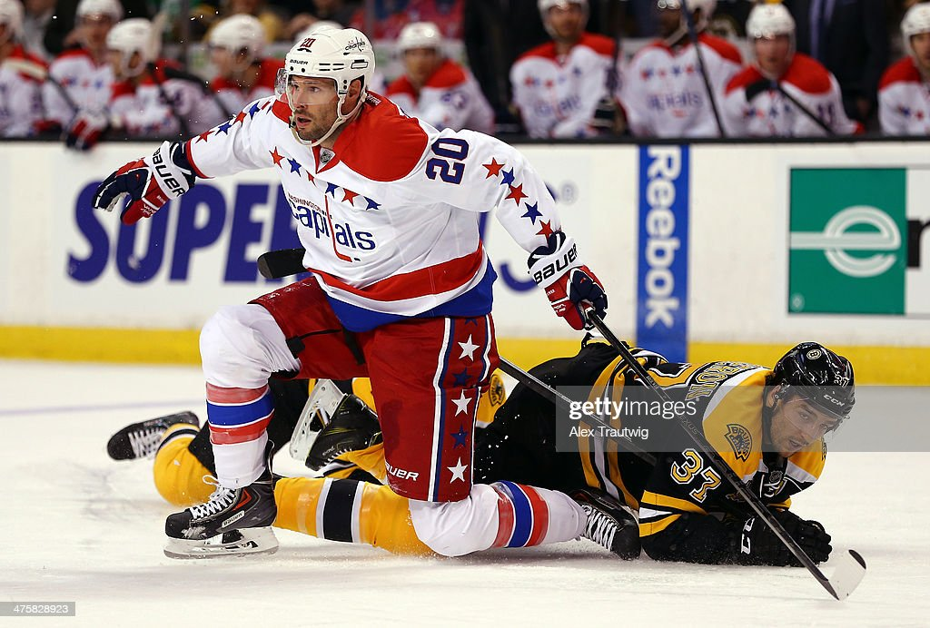 <a gi-track='captionPersonalityLinkClicked' href=/galleries/search?phrase=Troy+Brouwer&family=editorial&specificpeople=4155305 ng-click='$event.stopPropagation()'>Troy Brouwer</a> #20 of the Washington Capitals gets tangled with <a gi-track='captionPersonalityLinkClicked' href=/galleries/search?phrase=Patrice+Bergeron&family=editorial&specificpeople=204162 ng-click='$event.stopPropagation()'>Patrice Bergeron</a> #37 of the Boston Bruins during a game at the TD Garden on March 1, 2014 in Boston, Massachusetts.