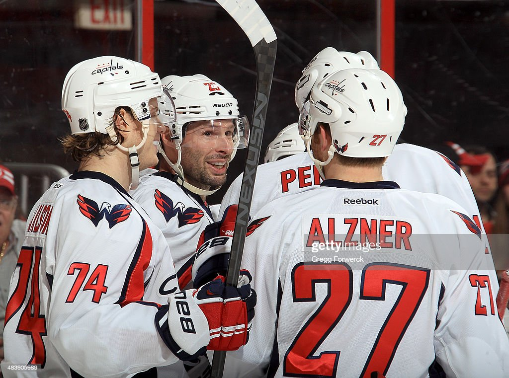 <a gi-track='captionPersonalityLinkClicked' href=/galleries/search?phrase=Troy+Brouwer&family=editorial&specificpeople=4155305 ng-click='$event.stopPropagation()'>Troy Brouwer</a> #20 of the Washington Capitals is surrounded by teammates following his second-period goal against the Carolina Hurricanes during their NHL game at PNC Arena on April 10, 2014 in Raleigh, North Carolina.