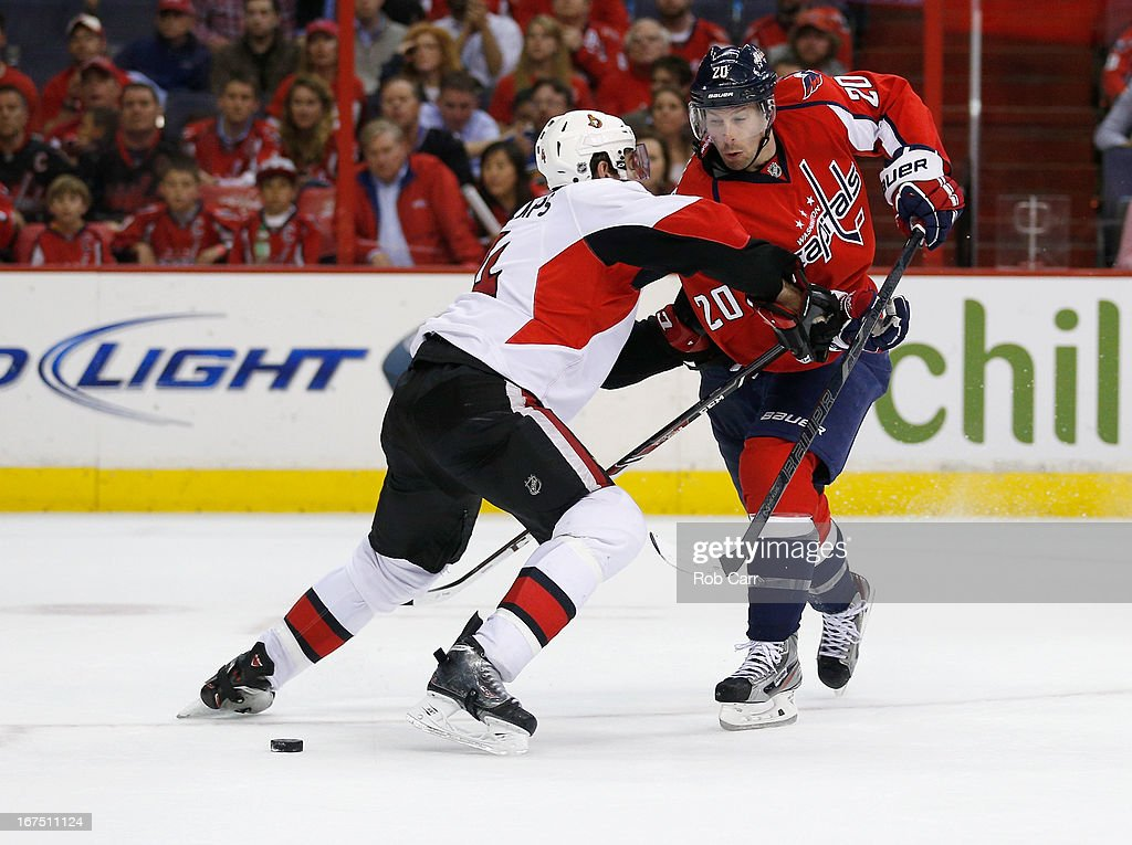 <a gi-track='captionPersonalityLinkClicked' href=/galleries/search?phrase=Troy+Brouwer&family=editorial&specificpeople=4155305 ng-click='$event.stopPropagation()'>Troy Brouwer</a> #20 of the Washington Capitals moves the puck around Chris Phillips #4 of the Ottawa Senators during the third period of the Senators 2-1 overtime win at Verizon Center on April 25, 2013 in Washington, DC.