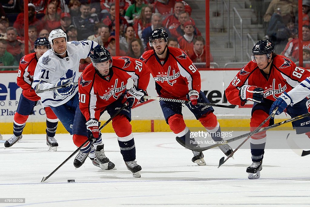 <a gi-track='captionPersonalityLinkClicked' href=/galleries/search?phrase=Troy+Brouwer&family=editorial&specificpeople=4155305 ng-click='$event.stopPropagation()'>Troy Brouwer</a> #20 of the Washington Capitals moves the puck up ice in the third period during an NHL game against the Toronto Maple Leafs at Verizon Center on March 16, 2014 in Washington, DC.