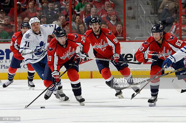 Troy Brouwer of the Washington Capitals moves the puck up ice in the third period during an NHL game against the Toronto Maple Leafs at Verizon...