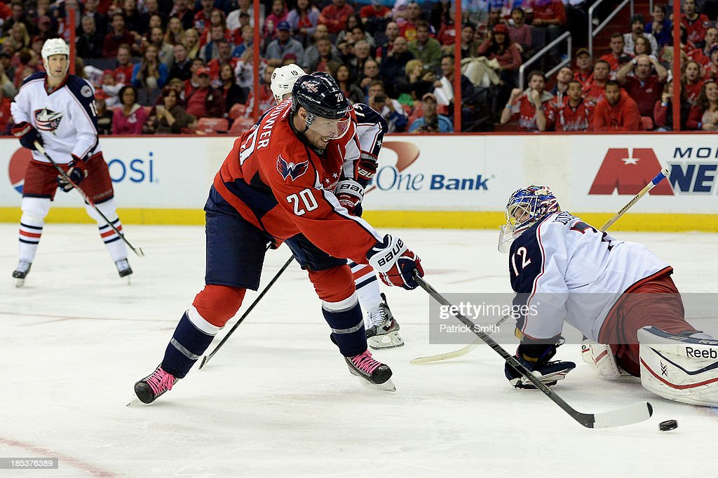 <a gi-track='captionPersonalityLinkClicked' href=/galleries/search?phrase=Troy+Brouwer&family=editorial&specificpeople=4155305 ng-click='$event.stopPropagation()'>Troy Brouwer</a> #20 of the Washington Capitals scores a goal against the Columbus Blue Jackets in the third period at the Verizon Center on October 19, 2013 in Washington, DC.