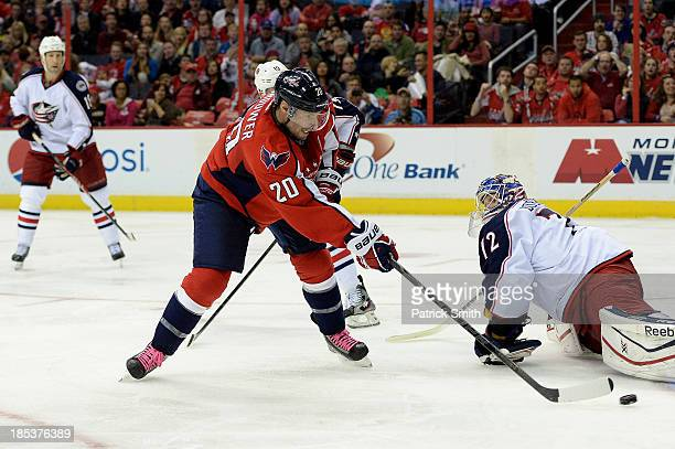 Troy Brouwer of the Washington Capitals scores a goal against the Columbus Blue Jackets in the third period at the Verizon Center on October 19 2013...