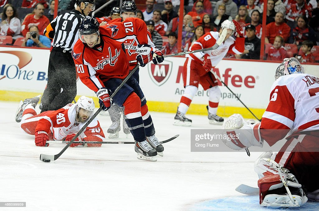<a gi-track='captionPersonalityLinkClicked' href=/galleries/search?phrase=Troy+Brouwer&family=editorial&specificpeople=4155305 ng-click='$event.stopPropagation()'>Troy Brouwer</a> #20 of the Washington Capitals shoots and scores in the third period against the Detroit Red Wings at Verizon Center on February 2, 2014 in Washington, DC. Washington won the game 6-5 in overtime.