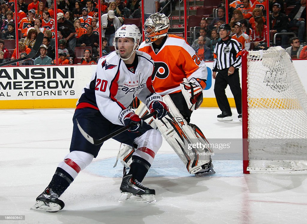 <a gi-track='captionPersonalityLinkClicked' href=/galleries/search?phrase=Troy+Brouwer&family=editorial&specificpeople=4155305 ng-click='$event.stopPropagation()'>Troy Brouwer</a> #20 of the Washington Capitals skates against <a gi-track='captionPersonalityLinkClicked' href=/galleries/search?phrase=Ray+Emery&family=editorial&specificpeople=218109 ng-click='$event.stopPropagation()'>Ray Emery</a> #29 of the Philadelphia Flyers on November 1, 2013 at the Wells Fargo Center in Philadelphia, Pennsylvania. The Capitals went on to defeat the Flyers 7-0.