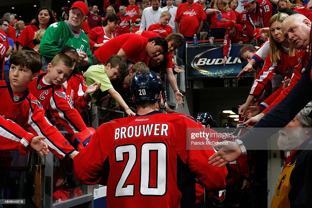 Troy Brouwer #20 of the Washington Capitals walks to the locker room after a 1-0 loss against the Tampa Bay Lightning in a shootout at Verizon Center on April 13, 2014 in Washington, DC.