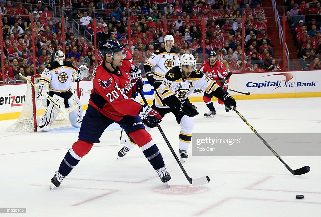 <a gi-track='captionPersonalityLinkClicked' href=/galleries/search?phrase=Troy+Brouwer&family=editorial&specificpeople=4155305 ng-click='$event.stopPropagation()'>Troy Brouwer</a> #20 of the Washington Capitals works the puck past <a gi-track='captionPersonalityLinkClicked' href=/galleries/search?phrase=Patrice+Bergeron&family=editorial&specificpeople=204162 ng-click='$event.stopPropagation()'>Patrice Bergeron</a> #37 of the Boston Bruins durng the third period of the Bruins 4-2 loss at Verizon Center on March 29, 2014 in Washington, DC.