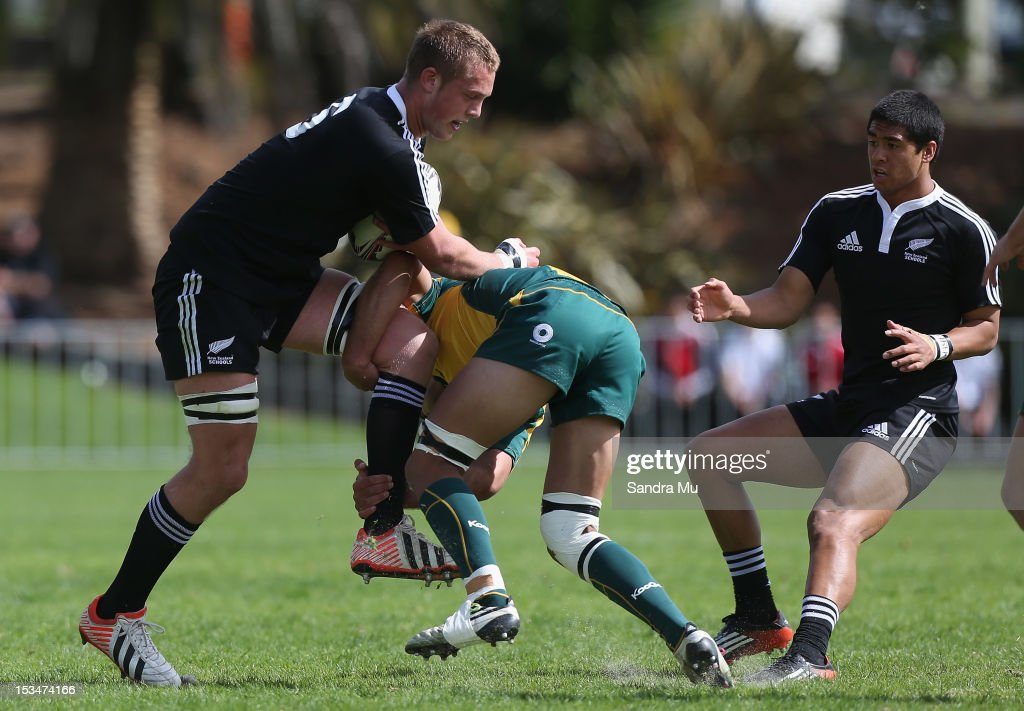 Troy Callander of New Zealand is tackled during the Test between New Zealand Schools and Australia Schools at Auckland Grammar on October 6, 2012 in Auckland, New Zealand.