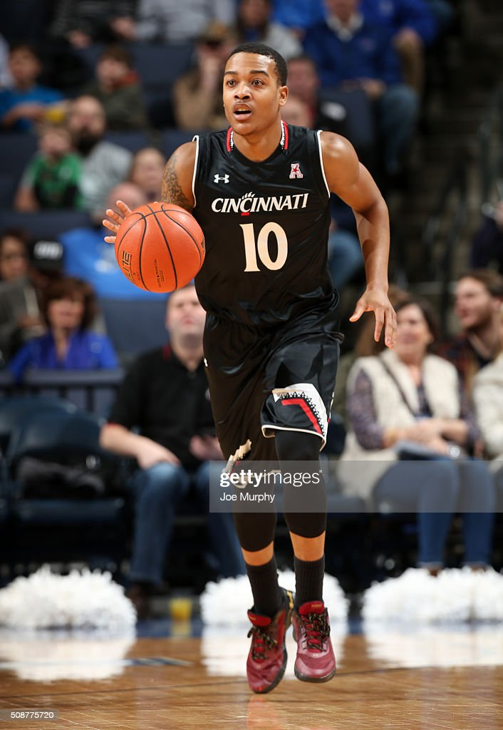 Troy Caupain #10 of the Cincinnati Bearcats dribbles the ball upcourt against the Memphis Tigers on February 6, 2016 at FedExForum in Memphis. Memphis defeated Cincinnati 63-59.