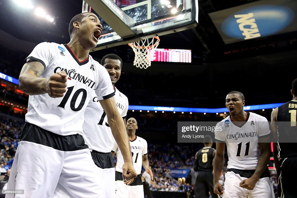 Troy Caupain #10 of the Cincinnati Bearcats reacts against the Purdue Boilermakers in the second half during the second round of the 2015 NCAA Men's Basketball Tournament at the KFC YUM! Center on March 19, 2015 in Louisville, Kentucky.