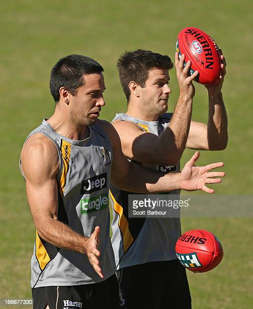Troy Chaplin and Trent Cotchin of the Tigers compete for the ball during a Richmond Tigers AFL training session at ME Bank Centre on April 16 2013 in...