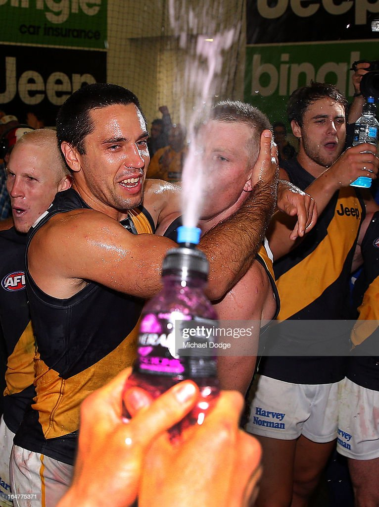 A Troy Chaplin (L) of the Tigers celebrates his first win at the club with Jack Riewoldt during the round one AFL match between the Carlton Blues and the Richmond Tigers at Melbourne Cricket Ground on March 28, 2013 in Melbourne, Australia.