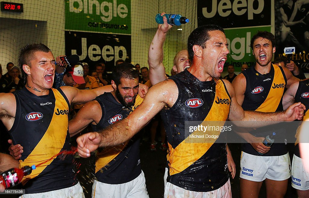 A Troy Chaplin of the Tigers celebrates his first win at the club with the team during the round one AFL match between the Carlton Blues and the Richmond Tigers at Melbourne Cricket Ground on March 28, 2013 in Melbourne, Australia.