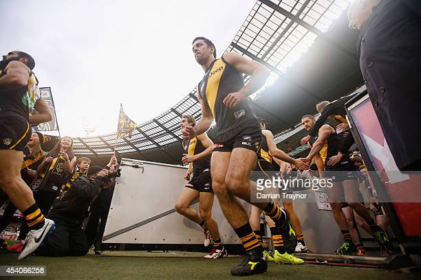 Troy Chaplin of the Tigers runs out before the round 22 AFL match between the Richmond Tigers and the St Kilda Saints at Melbourne Cricket Ground on...