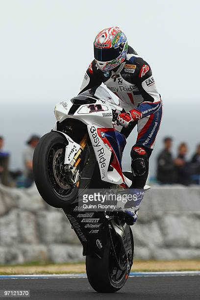 Troy Corser of Australia and the BMW Motorrad Motorsport Team pops a mono during qualifying practise for round one of the Superbike World...