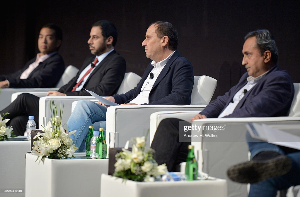 Troy Craig Poon, CEO of Perfect Storm Entertainment, Julien Khabbaz, Head of Investment Banking at FFA Private Bank, Khalil Benkirane and Sanjeev Lamba, CEO of Reliance Entertainment attend the Cinematic Innovation Summit ahead of the 10th Annual Dubai International Film Festival at Atlantis, The Palm Hotel on December 6, 2013 in Dubai, United Arab Emirates.