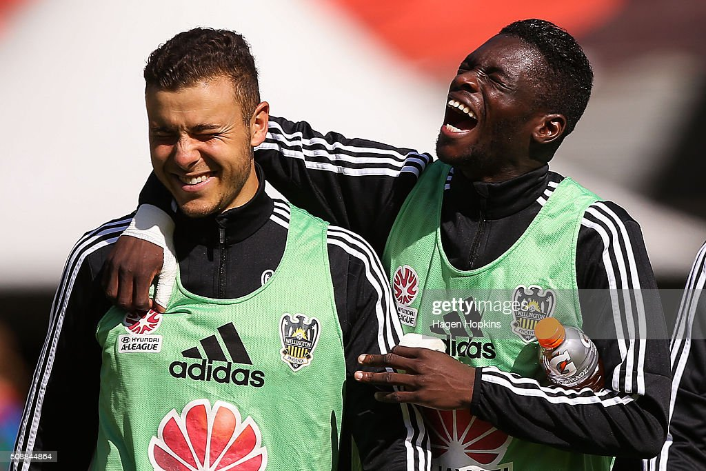 Troy Danaskos and Kwabena Appiah of the Phoenix share a laugh during the round 18 A-League match between Wellington Phoenix and Perth Glory at Westpac Stadium on February 7, 2016 in Wellington, New Zealand.