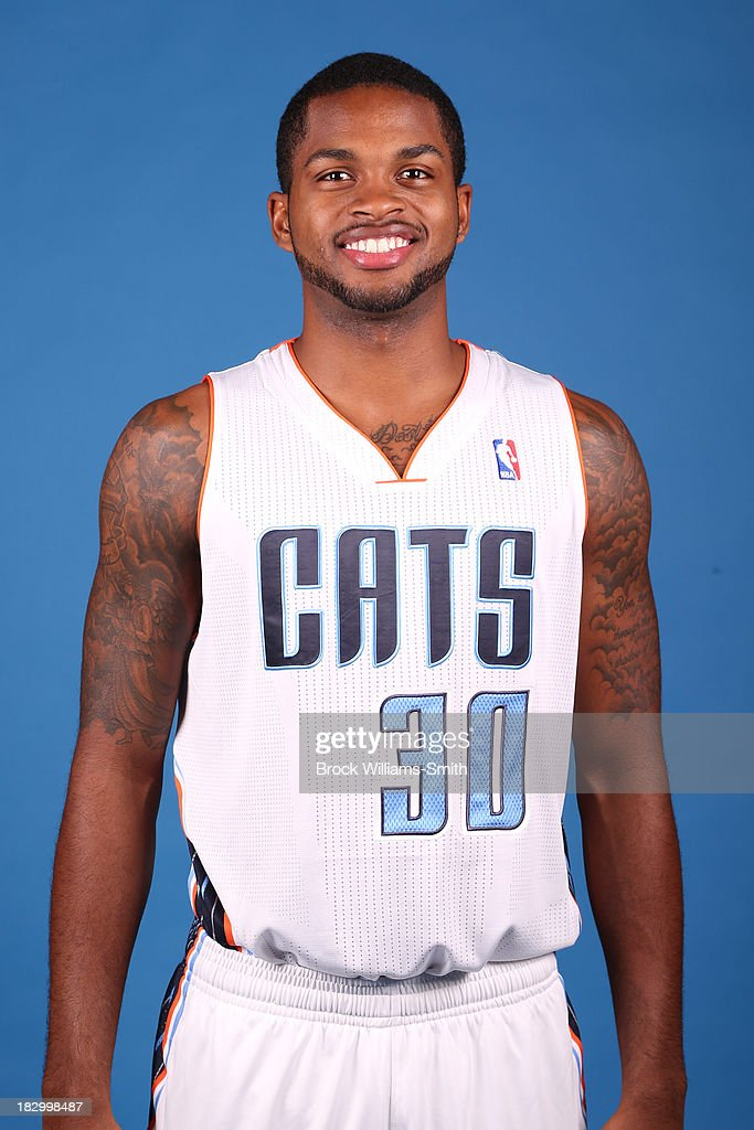 Troy Daniels #30 of the Charlotte Bobcats poses for media day at the Time Warner Cable Arena on September 20, 2013 in Charlotte, North Carolina.