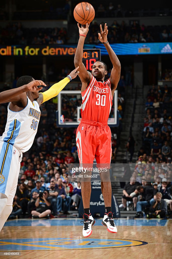 Troy Daniels #30 of the Houston Rockets shoots against the Denver Nuggets on April 9, 2014 at the Pepsi Center in Denver, Colorado.