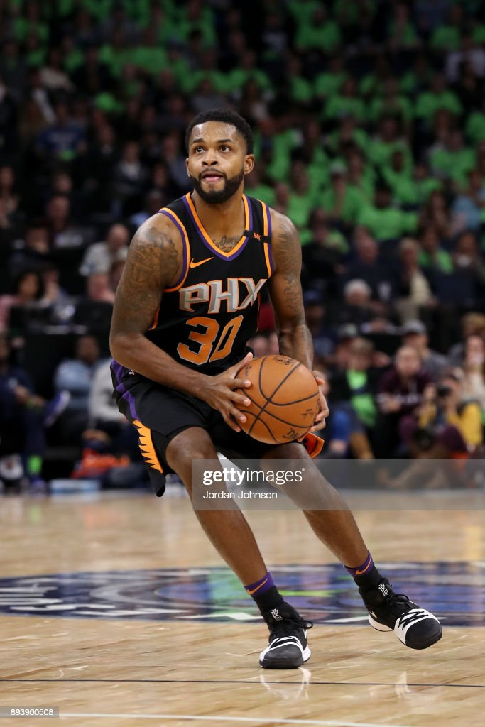 Troy Daniels #30 of the Phoenix Suns handles the ball against the Minnesota Timberwolves on December 16, 2017 at Target Center in Minneapolis, Minnesota.